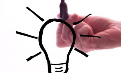 Lightbulb, marker and hand.