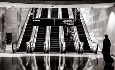 People using escalator in a subway