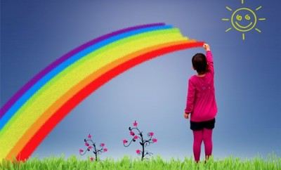 Little girl painting a rainbow on the sky - Joy and happiness in childhood